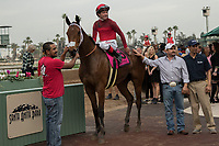 ARCADIA, CA  JANUARY 06: #8 Itsinthepost, ridden by Tyler Baze, n the winners circle after winning the San Gabriel Stakes (Grade ll) on January 6, 2018, at Santa Anita Park in Arcadia, CA.(Photo by Casey Phillips/ Eclipse Sportswire/ Getty Images)