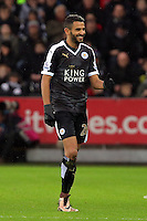 Riyad Mahrez of Leicester City celebrates his second goal during the Barclays Premier League match between Swansea City and Leicester City at the Liberty Stadium, Swansea on December 05 2015