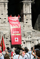 "Manifestazione della Cgil  in occasione dello sciopero generale indetto contro la manovra economica del governo, a Roma, 6 settembre 2011..Demonstrators gather during a rally in occasion of the general strike called by the Italian CGIL main union against the government's proposed austerity package, in Rome, 6 september 2011. The banner reads ""They protect rich, sell off Italy. Let's stop them!!! Labour common asset""..UPDATE IMAGES PRESS/Riccardo De Luca"