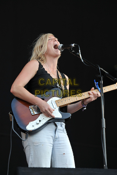 Lissie.Performing live at Hard Rock Calling, Hyde Park London, England, UK, .June 25th 2011..music festival concert gig on stage half length microphone singing black top playing guitar  vest  white jeans .CAP/MAR.© Martin Harris/Capital Pictures.