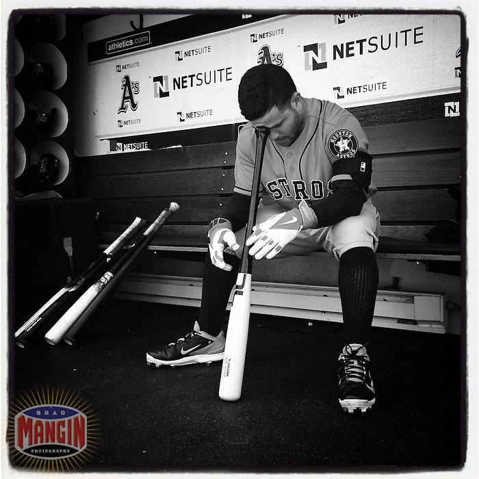 OAKLAND, CA - JULY 24: Instagram of Jose Altuve of the Houston Astros sitting in the dugout before the game against the Oakland Athletics at O.co Coliseum on July 24, 2014 in Oakland, California. Photo by Brad Mangin