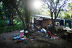 "November 08, 2014. ""Water it´s the real thing""<br /> Raquel lives with her family in a house in Nejapa (El Salvador). Life is so difficult for her because she does'n' t have water at home. The people of Nejapa have no drinking water because the Coca -Cola company overexploited the aquifer in the area, the most important source of water in this Central American country. This means that the population has to walk for hours to get water from wells and rivers. The problem is that these rivers and wells are contaminated by discharges that makes Coca- Cola and other factories that are installed in the area. The problem can increase: Coca Cola company has expansion plans, something that communities and NGOs want to stop. To make a liter of Coca Cola are needed 2,4 liters of water. ©Calamar2/ Pedro ARMESTRE"