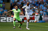 Nicolas Otamendi of Manchester City and Andre Ayew of Swansea City in action during the Barclays Premier League match between Swansea City and Manchester City played at The Liberty Stadium, Swansea on 15th May 2016