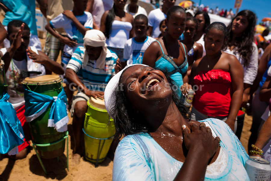 A Candomblé worshipper becomes possessed during the festival of Yemanjá, the goddess of the sea, in Salvador, Bahia, Brazil, 2 February 2012. Yemanjá, originally from the ancient Yoruba mythology, is one of the most popular ?orixás?, the deities from the Afro-Brazilian religion of Candomblé. Every year on February 2nd, thousands of Yemanjá devotees participate in a colorful celebration in her honor. Faithful, usually dressed in the traditional white, gather on the beach at dawn to leave offerings for their goddess. Gifts for Yemanjá include flowers, perfumes or jewelry. Dancing in the circle and singing ancestral Yoruba prayers, sometimes the followers enter into a trance and become possessed by the spirits. Although Yemanjá is widely worshipped throughout Latin America, including south of Brazil, Uruguay, Cuba or Haiti, the most popular cult is maintained in Bahia, Brazil.
