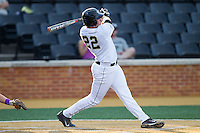 Will Craig (22) of the Wake Forest Demon Deacons follows through on his swing against the High Point Panthers at Wake Forest Baseball Park on April 2, 2014 in Winston-Salem, North Carolina.  The Demon Deacons defeated the Panthers 10-6.  (Brian Westerholt/Four Seam Images)
