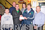 Enda Walshe, Killarney Legion GAA club, pictured as he presented Freddie Murphy, Killarney, who won €11,400 in the club lotto recently. Also pictured are Finbarr Murphy, William O'Sullivan, Emma Murphy and Sean Murphy.