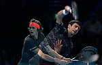 London UK 18h November 2018 Nitto ATP World Tour Finals at 02 Arena London UK Final: Novak Djokovic SRB Vs Alexander Zverev GER double exposure of Djokovic and Zverev in action during the match which was won by Zverev 6-4 6-3