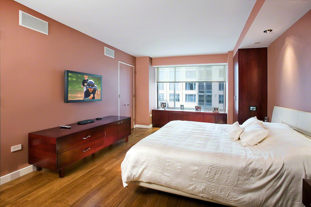 Bedroom With In Wall Speakers And Flat Panel TV