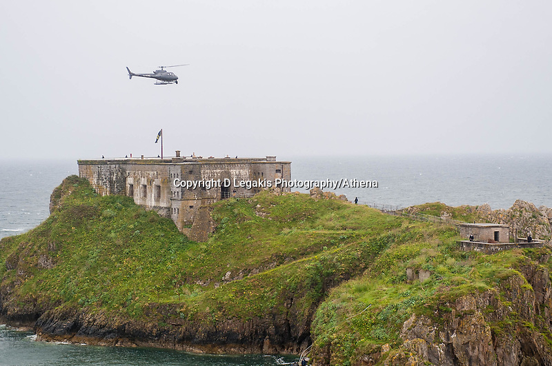 Tuesday  28 June 2016<br /> Pictured: Cast members act ut a scene  with guns on the island while a helicopter takes aerial shots <br /> Re: Sherlock filming on St.Catherines Island, Wales, UK