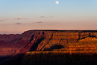 United States, Arizona, Grand Canyon. Sunset at Lipan Point, with a full moon hanging above Grand Canyon.