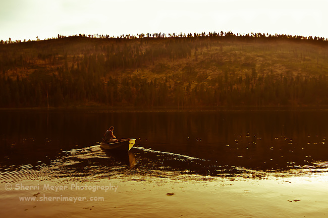 Man fishing on Blue Lake in the Modoc National Forest, Northeastern California.