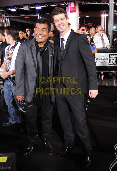 GEORGE LOPEZ & ROBIN THICKE.TThe Hard Rock Cafe Hollywood's grand opening party in Hollywood, California, USA..October 21st, 2010.full length suit black white grey gray jacket .CAP/RKE/DVS.©DVS/RockinExposures/Capital Pictures.