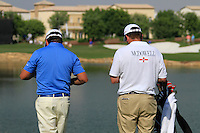 Graeme McDowell and caddy wait on the par3 6th tee during Day 1 of the Dubai World Championship, Earth Course, Jumeirah Golf Estates, Dubai, 25th November 2010..(Picture Eoin Clarke/www.golffile.ie)