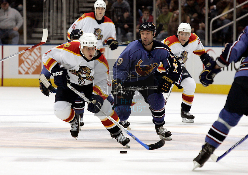 Florida Panthers defenseman Joel Kwiatkowski controls the puck in the second period against the Atlanta Thrashers at Philips Arena. The Thrashers won the game 1-0.<br />