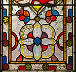 Stained glass window geometric design circa 1870 by Ward and Hughes, church of Saint Andrew, Bramfield, Suffolk, England, UK