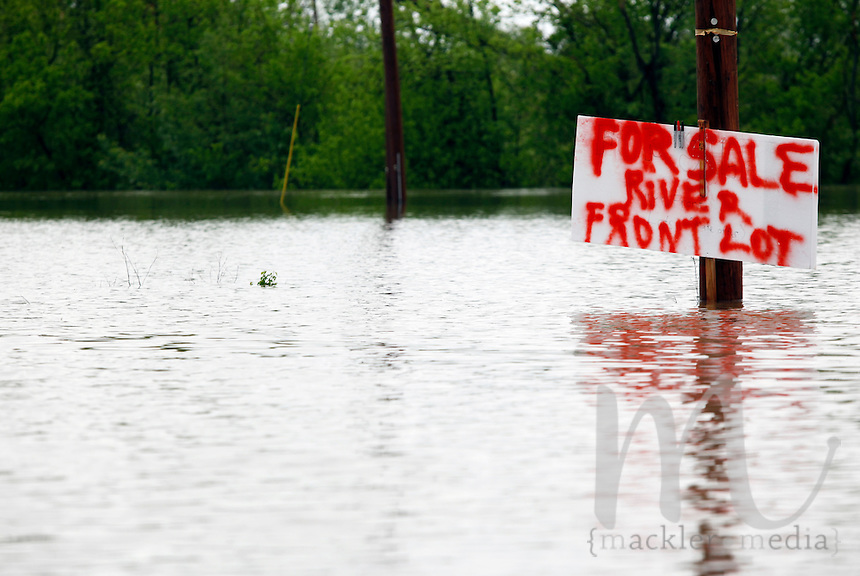 """A sign near the intersection of Water Street and Fourth Street proclaims """"For Sale River Front Lot,"""" which submerged in four-feet-deep Mississippi River floodwater in the Red Star District of Cape Girardeau, MO, on Sunday, May 1, 2011."""
