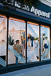 Visual Manager Will Gomez (in blue) and Visual Display Assistant Jacob Estevez design the window display at the American Apparel store located on Sunset Boulevard in the Echo Park neighborhood of Los Angeles, California February 6, 2015.