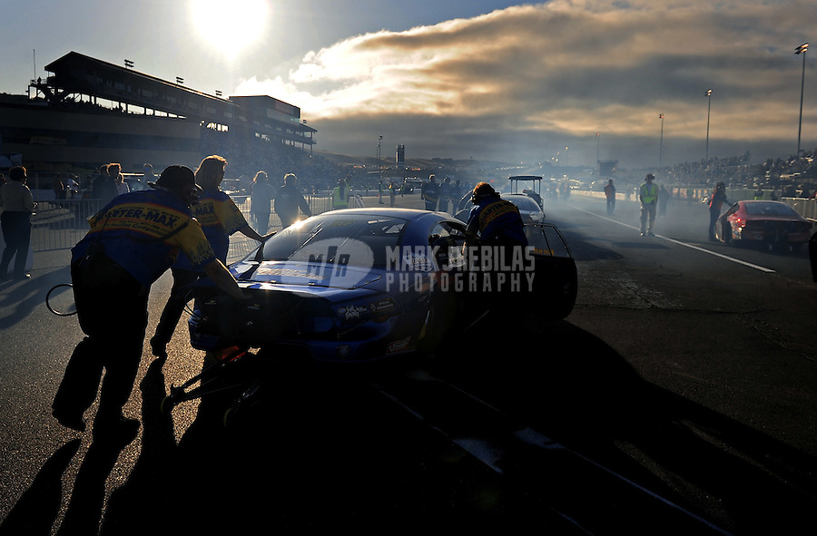 Jul. 24, 2009; Sonoma, CA, USA; NHRA pro stock driver Rickie Jones is pushed towards the starting line during qualifying for the Fram Autolite Nationals at Infineon Raceway. Mandatory Credit: Mark J. Rebilas-