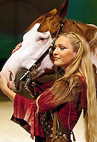 Cavalia rider Katie Cox from West Palm Beach, Florida embraces her Paint horse, Cisco, after a media preview show on July 17, 2012 in San Jose, California.
