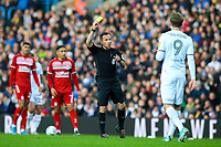 Referee Keith Stroud shows Leeds United's Patrick Bamford the yellow card<br /> <br /> Photographer Alex Dodd/CameraSport<br /> <br /> The EFL Sky Bet Championship - Leeds United v Middlesbrough - Saturday 30th November 2019 - Elland Road - Leeds<br /> <br /> World Copyright © 2019 CameraSport. All rights reserved. 43 Linden Ave. Countesthorpe. Leicester. England. LE8 5PG - Tel: +44 (0) 116 277 4147 - admin@camerasport.com - www.camerasport.com