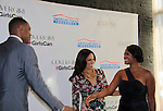 Allan Houston (NBA Basketball player) & Soledad O'Brien & Tatyana Ali at Soledad O'Brien and Brad Raymond Starfish Foundation presents New Orleans to New York City 2014 Gala on July 24, 2014 at Espace, New York City for VIP Cocktail Reception, dinner, entertainment with Grammy Award winning Trumpeteer Irvin Mayfield (also Board president) and the New Orleans Jazz Orchestra. (Photo by Sue Coflin/Max Photos)