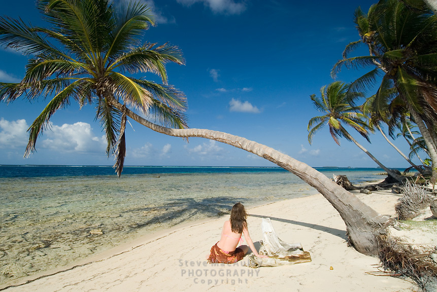 Woman playing along shoreline of tropical island, Comarca De Kuna Yala, San Blas Islands, Panama
