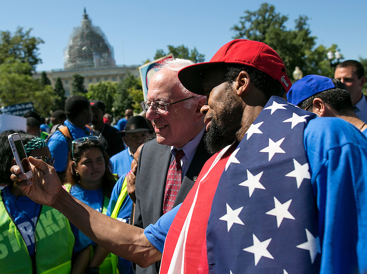 UNITED STATES - JULY 22: Democratic presidential candidate Sen. Bernie Sanders, I-Vt., takes a selfie with a supporter during a rally on Capitol Hill in Washington, Wednesday, July 22, 2015, to push for a raise to the minimum wage to $15 an hour. (Photo By Al Drago/CQ Roll Call)