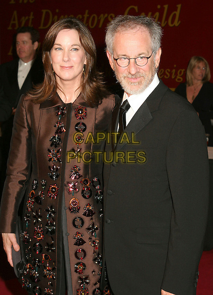 KATHLEEN KENNEDY & STEVEN SPEILBERG.Tenth Annual Art Directors Guild Awards held at the Beverly Hilton Hotel, Beverly Hills, California, USA,.11 February 2006..half length glasses beard.Ref: ADM/BP.www.capitalpictures.com.sales@capitalpictures.com.©Byron Purvis/AdMedia/Capital Pictures.