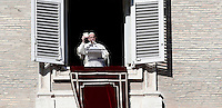 "Papa Francesco, durante la preghiera dell'Angelus in Piazza San Pietro, mostra un libro intitolato ""Icone di Misericordia"" che verrà distribuito ai fedeli. Città del Vaticano. 6 gennaio 2017.<br /> Pope Francis shows a booklet, titled ""Icons of Mercy"" that will be distributed to faithful, during the Angelus prayer from his studio's window overlooking St. Peter's square, at the Vatican, on January 6, 2017.<br /> UPDATE IMAGES PRESS/Isabella Bonotto<br /> <br /> STRICTLY ONLY FOR EDITORIAL USE"