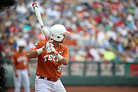 C.J Hinojosa #9 of the Texas Longhorns bats during Game 1 of the 2014 Men's College World Series between the UC Irvine Anteaters and Texas Longhorns at TD Ameritrade Park on June 14, 2014 in Omaha, Nebraska. (Brace Hemmelgarn/Four Seam Images)