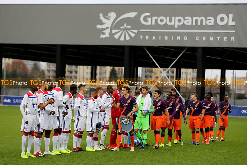 Manchester City captain, Colin Rosler, walks along the line to shake hands with the Lyon players ahead of kick-off during Lyon Under-19 vs Manchester City Under-19, UEFA Youth League Football at Groupama OL Academy on 27th November 2018
