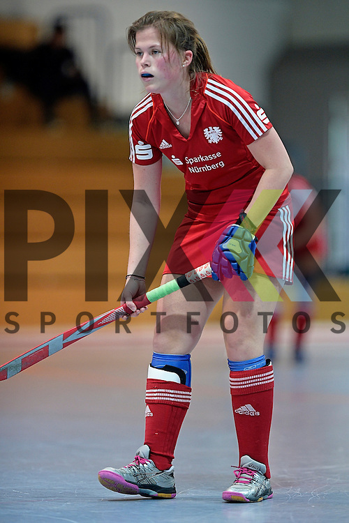GER - Mannheim, Germany, December 19: During the 1. Bundesliga Sued Damen indoor hockey match between Mannheimer HC (blue) and Nuernberger HTC (red) on December 19, 2015 at Irma-Roechling-Halle in Mannheim, Germany. Final score 8-2 (HT 3-2).  Jana Borgmann #28 of Nuernberger HTC<br /> <br /> Foto &copy; PIX-Sportfotos *** Foto ist honorarpflichtig! *** Auf Anfrage in hoeherer Qualitaet/Aufloesung. Belegexemplar erbeten. Veroeffentlichung ausschliesslich fuer journalistisch-publizistische Zwecke. For editorial use only.