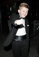 HARRY JOHNSON .At the Active Harry new campaign launch party, Embassy nightclub, London, England, UK, .February 9th 2011..half length black bow tie tux tuxedo hand fist punching gesture .CAP/CAN.©Can Nguyen/Capital Pictures.