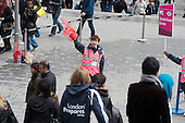 A steward directs crowds passing through the Stratford Centre on the day of the formal opening of the London 2012 Olympic Stadium.