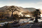 Epupa Falls of the Cunene River at the border between Angola and Namibia at sunrise.