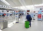 Person at self check in machine at Toronto Pearson International airport