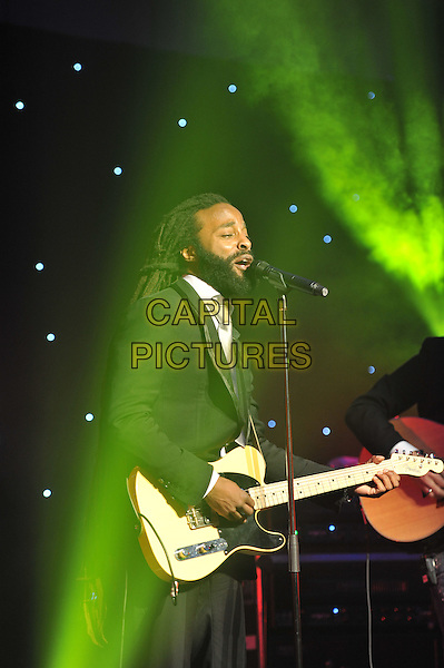 John Forte.'Global Angels Awards', The Park Plaza Hotel, Westminster, London, England. 2nd December 2011..music on stage live concert gig performing half length microphone singing black suit playing guitar .CAP/MAR.© Martin Harris/Capital Pictures.