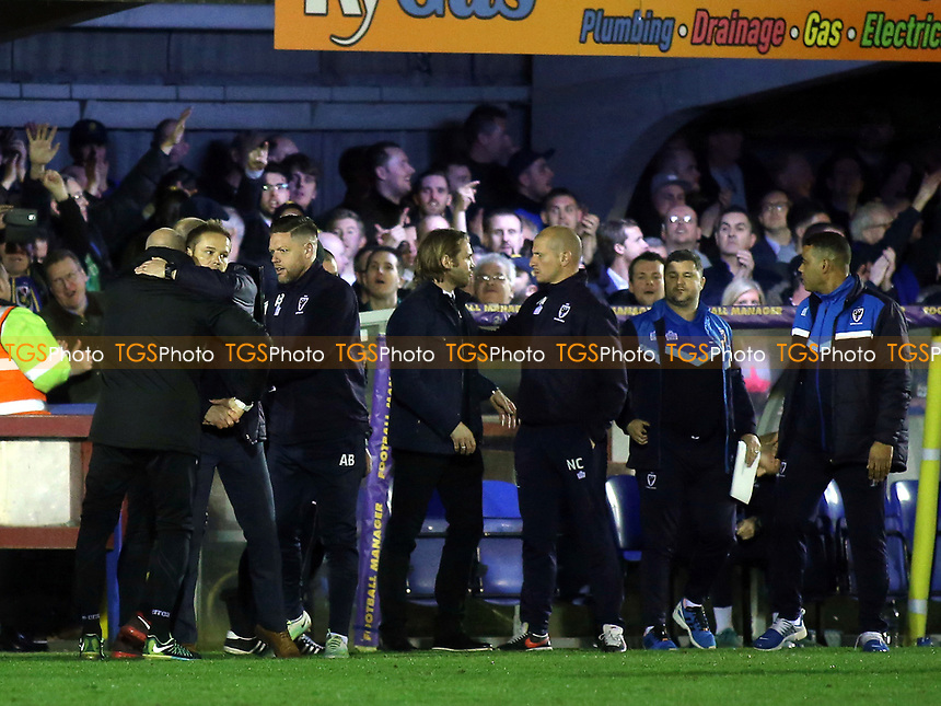 AFC Wimbledon Manager, Neal Ardley, embraces the MK Dons Coaching staff at the end of the match during AFC Wimbledon vs MK Dons, Sky Bet EFL League 1 Football at the Cherry Red Records Stadium on 14th March 2017