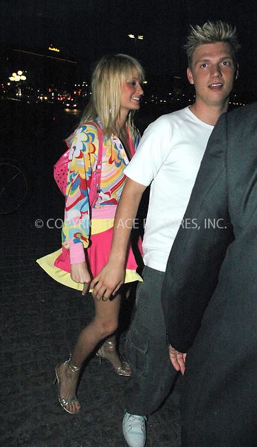 Paris Hilton going to Stockholm nightclubs together with boyfriend Nick Carter - 9 July 2004..FAMOUS PICTURES AND FEATURES AGENCY.tel  +44 (0) 20 7731 9333.fax +44 (0) 20 7731 9330.e-mail info@famous.uk.com.www.famous.uk.com.FAM13207