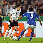 07.09.2010,  Rhein Energie Stadion, Koeln, GER, EM-Qualifikation, Deutschland vs. Aserbaidschan, im Bild: Mesut Oezil (Deutschland #8, Madrid) / Elnur Allahverdiyev (Aserbaidschan #5)  Foto © nph / Mueller