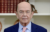 United States Secretary of Commerce Wilbur Ross looks on before U.S. President Donald Trump signs Executive Orders regarding trade in the Oval Office of the White House March 31, 2017 in Washington, DC. Photo Credit: Olivier Douliery/CNP/AdMedia