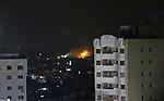 A picture taken from Gaza City on May 30, 2018, shows a fire and smoke billowing in the background following an Israeli air strike on the Palestinian enclave. The Israeli Defense Forces (IDF) said it launched more than 35 airstrikes targeting the militant groups Hamas and Islamic Jihad, after approximately 70 rockets and mortars were fired toward Israeli territory Tuesday morning. Photo by Ashraf Amra