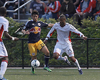 New York Red Bulls defender Kosuke Kimura (27) brings the ball forward as New England Revolution defender Darrius Barnes (25) defends. 2013 Lamar Hunt U.S Open Cup fourth round, New England Revolution (white) defeated New York Red Bulls (blue/yellow), 4-2, at Harvard University's Soldiers Field Soccer Stadium on June 12, 2013.