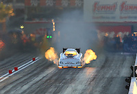 Oct 31, 2015; Las Vegas, NV, USA; NHRA funny car driver Tim Gibbons explodes an engine on fire during qualifying for the Toyota Nationals at The Strip at Las Vegas Motor Speedway. Mandatory Credit: Mark J. Rebilas-USA TODAY Sports