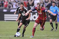 D.C. United forward Josh Wolff (16) shields the ball against Real Salt Lake defender Nat Borchers (6). D.C. United defeated Real Salt Lake 4-1 at RFK Stadium, Saturday September 24 , 2011.