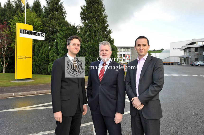 Pictured outside the Liebherr Crane factory in Killarney are from left, Rudolf Ganser, Director, Pat O'Leary, Managing Director and Skender Mirakaj, Director..Picture by Don MacMonagle