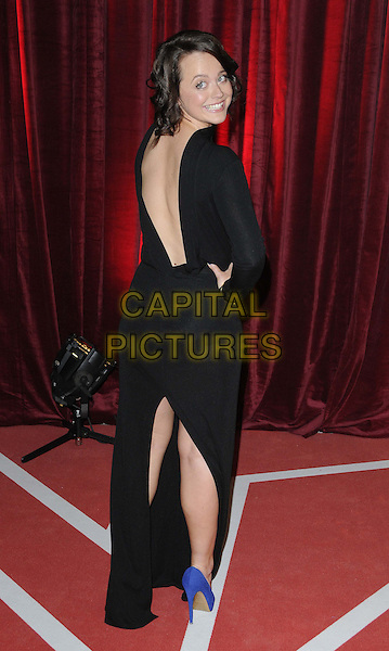 Charlie Clemmow.attended the British Soap Awards 2013, Media City, Salford, Manchester, England, UK, 18th May 2013..arrivals full length black dress sheer see thru through long sleeve maxi high neck back rear behind over shoulder cut out  low hand on hip blue cobalt shoes  slit split .CAP/CAN.©Can Nguyen/Capital Pictures.