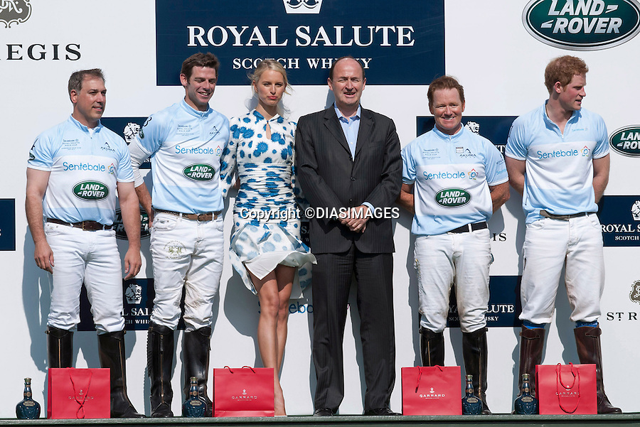 """PRINCE HARRY AND KAROLINA KURKOVA (Blowing Dress).at the presentation of the prizes at the end of the Sentabale Charity Polo Match at the Greenwich Polo Club, Conneticut_15/05/2013.Prince Harry is on a week long USA visit the includes Washington, Denver, Colorado Springs, New Jersey, New York and Conneticut..Mandatory credit photo:©DIASIMAGES..(Failure to credit will incur a surcharge of 100% of reproduction fees)..**ALL FEES PAYABLE TO: """"NEWSPIX  INTERNATIONAL""""**..Newspix International, 31 Chinnery Hill, Bishop's Stortford, ENGLAND CM23 3PS.Tel:+441279 324672.Fax: +441279656877.Mobile:  07775681153.e-mail: info@newspixinternational.co.uk"""
