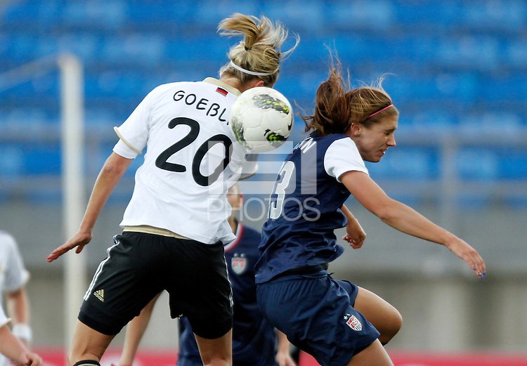 US's Alex Morgan fights for the ball with Germany's Lena Goebling during their Algarve Women's Cup soccer match at Algarve stadium in Faro, March 13, 2013.  .Paulo Cordeiro/ISI