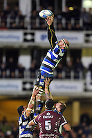 Matt Garvey rises high to win lineout ball. Amlin Challenge Cup match, between Bath Rugby and Bordeaux-Begles on January 16, 2014 at the Recreation Ground in Bath, England. Photo by: Patrick Khachfe / Onside Images